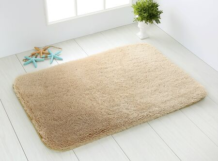 brown bathroom carpet on white wooden floor