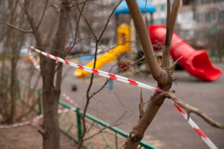 a playground fenced with warning tape. Virus. stay home