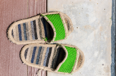 comfortable: old slippers is wear comfortable , healthy feet. Stock Photo