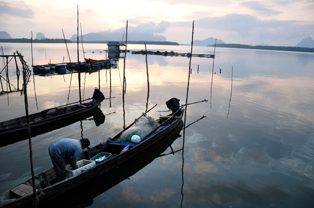 long tailed boat: Fishermen long tailed boat to fish Stock Photo