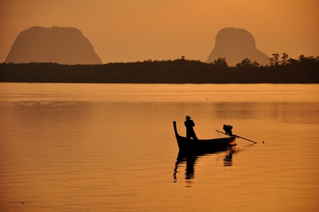 long tailed boat: Fishermen long tailed boat to fish at sunset Stock Photo