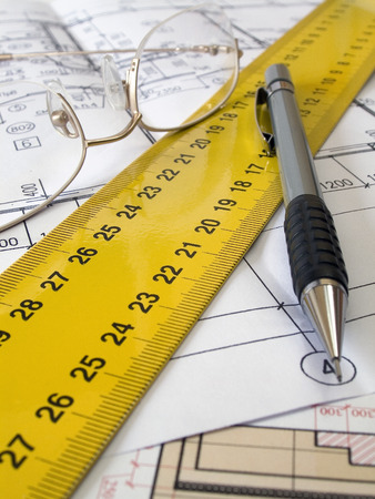 square ruler: A pencil and geometric tools on top of a floor plan  Stock Photo