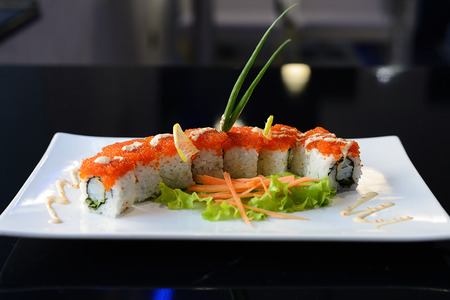 roll bar: Japanese sushi on a white plate.