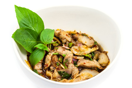 namtok: Grilled Pork in North Eastern Thai Style Spicy Salad on white background