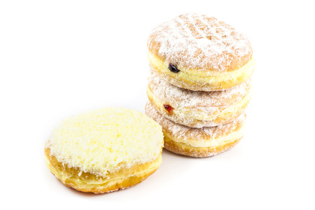 biscuit factory: close up stack of  donut on white background