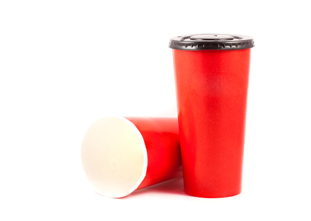close up red paper cup on white background photo