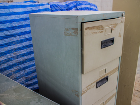 Shot of a filing cabinet reading hired and fired  The  photo