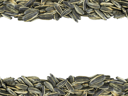 upperdeck view: Pile of sunflower seeds against a white background