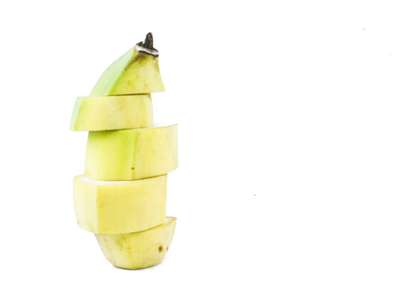 Banana, yellow, green, chipped arranged vertically on white background. photo