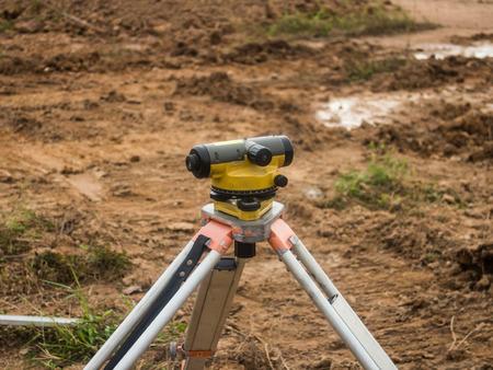 tacheometer: Surveying measuring equipment level theodolite on tripod at construction site