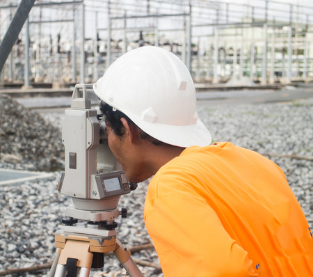 topographical: Surveyor engineer on the substation