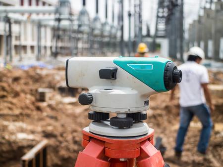 tacheometer: Surveyor equipment tacheometer or theodolite outdoors at construction site Stock Photo