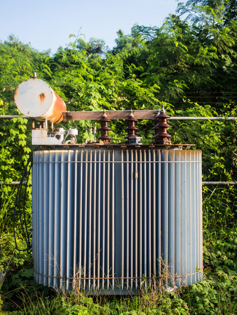 isolators: old High-voltage power transformer in substation