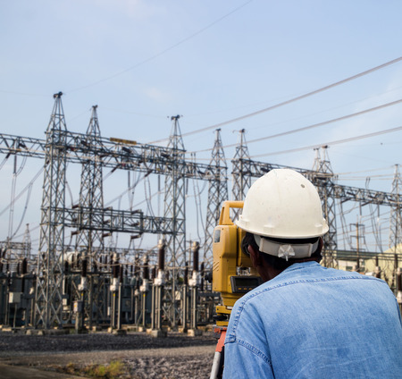 Surveyor engineer on the substation photo