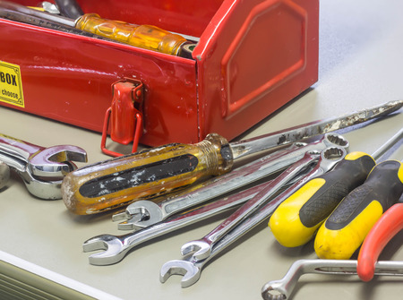 journeyman technician: Well used old tools and red tool box