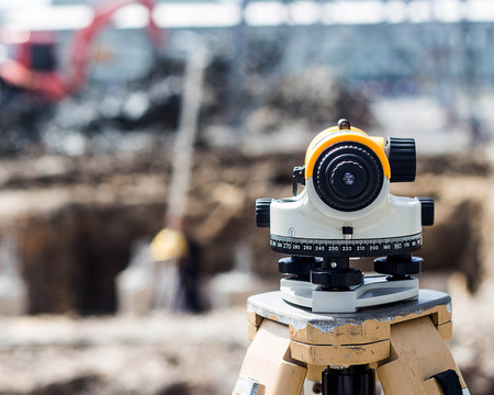 Surveyor equipment tacheometer or theodolite outdoors at construction site photo