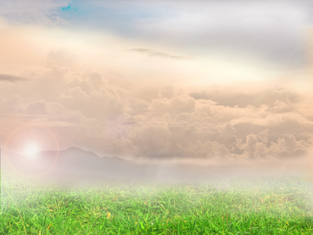 mountains and sky: background consists of grass, mountains, sky, cloud.