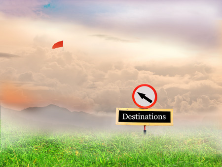mountains and sky: Signs pointing the way to the flag of success and background lawn, mountains, sky.