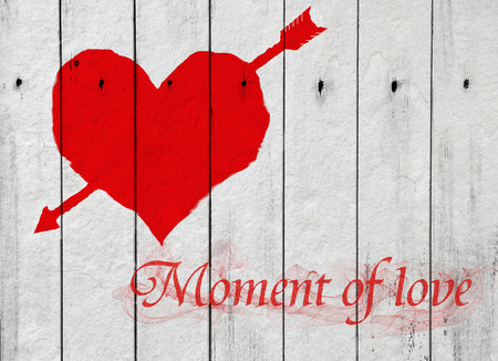 heart and word Moment of love on white wood background Vintage Style photo
