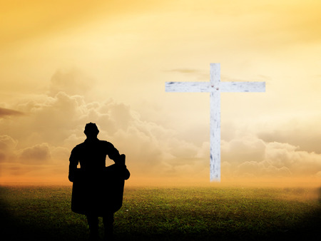 protection of the bible: Silhouette engineer looking blueprint inspection of the blurred Cross over beautiful sunset Stock Photo