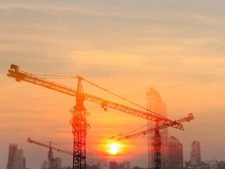 concrete commercial block: Tower Cranes on Construction Site Stock Photo