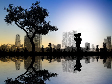 Silhouettes baby boy with camera shooting tree over blurred City Scape. Likened to a single tree in a big city kid I kept looking. Environmental concept