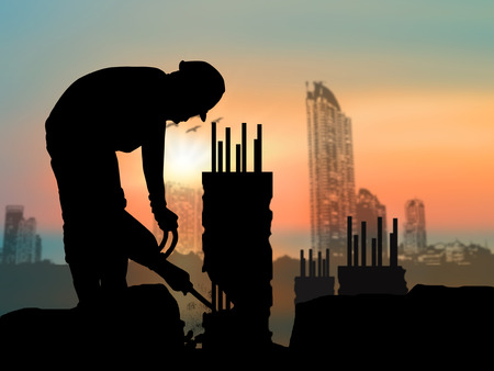 silhouette of construction worker on construction site Standard-Bild