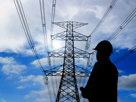 silhouette of engineers standing at electricity station 版權商用圖片 - 42159027