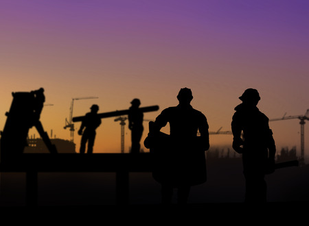 silhouette of architect looking at blueprints in a building site over Blurred construction worker on construction site
