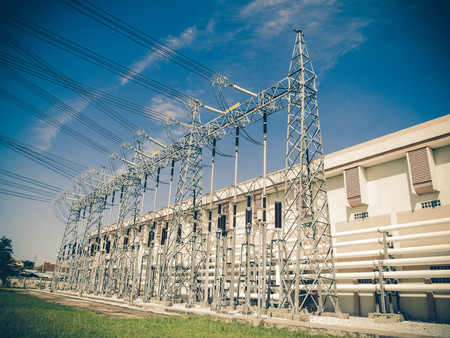 in a row: A row of tower with high voltage gas
