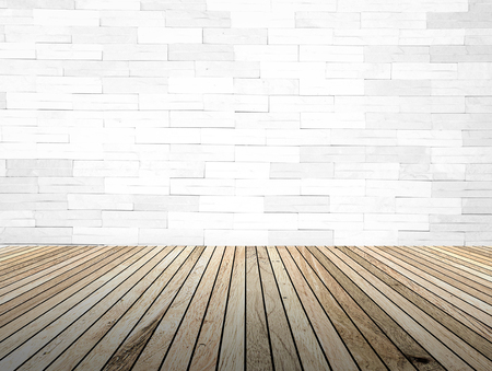brick floor: perspective wood plank floor with over blur Brick wall background