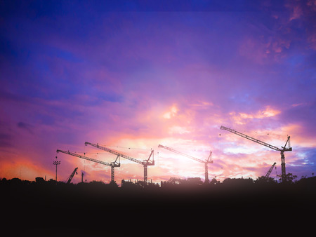 construction worker: silhouette engineer  in a building site over Blurred construction site Stock Photo