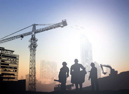 concrete construction: silhouette engineer  in a building site over Blurred construction site Stock Photo
