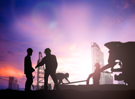 silhouette engineer looking work a building site over Blurred construction worker on construction site