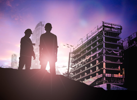 silhouette engineer looking  building site over Blurred construction worker on construction site