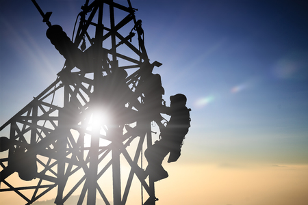 Silhouetteblack man  electrical engineer and electrical workers are installing high voltage systems over blur night city