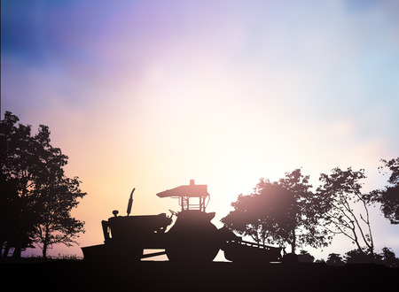 nontoxic: Silhouette Harvesting machine on a farm planted with vegetables, organic, non-toxic treatments. Food concept, business concept, the lifestyle concept, the agricultural industry concept.