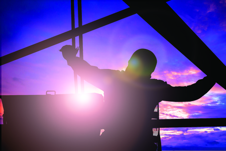 ensure: Silhouette Mechanical Engineer Check the machine before starting work to ensure the safety of workers over the machine will blur and colleagues.