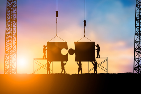 Silhouette Team business engineer work connecting jigsaw puzzle pieces together over blurred natural background  pastel.Teamwork potential and motivate employee to growth:Business and people concept