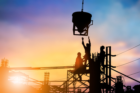 Silhouette Construction workers work on a team with high security standards of the world over blurred pastel background .industry,Business, standards, training, specific, professional license, safety