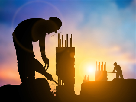 Coworking process, designers team working modern construction.Photo young working showing new startup idea over blurred natural background sunset pastel. heavy industry and safety at work concept. Stock fotó