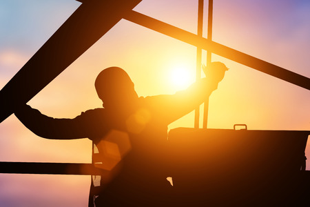 Silhouette Mechanical Engineer Check the machine before starting work to ensure the safety of workers over the machine will blur and colleagues.