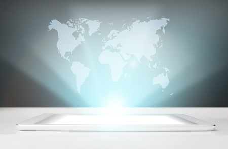 Working a hologram of the earth on the tablet. omnichannel icon flow.Elements of this image are furnished by NASA 版權商用圖片