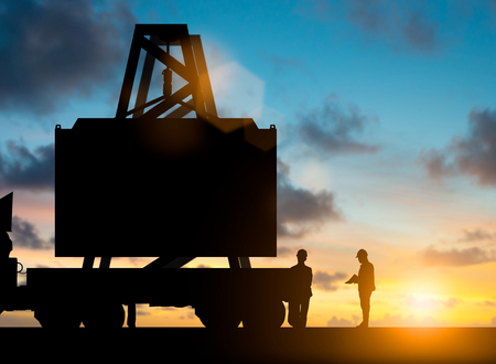 Silhouette inspector check list as a list of containers at the port up to send customers over blurred natural background sunset pastel.Business Logistics and Transportation concept.flare light