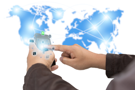 Business,communications,connection,technology concept.businessman using smartphone upload data Business over blurred World map shows the network of communication links.technology.select focus 版權商用圖片