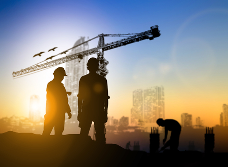 silhouette engineer construction site over Blurred construction worker on construction site