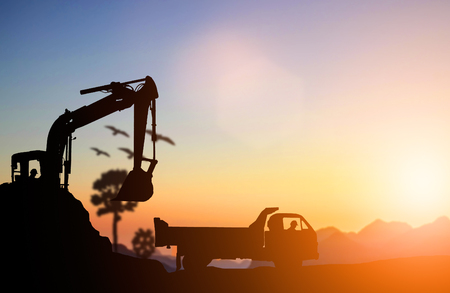silhouette Excavator and truck working at construction site. Construction used heavy machinery to move earth. concept construction and heavy industry, machine will be used in heavy industry business.
