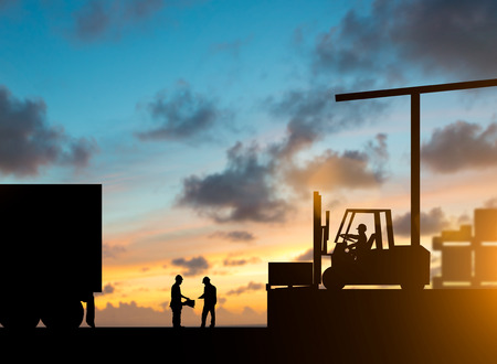 allowance: Silhouette inspector are examining the waybill with the Forklift. truck bringing up the goods in warehouses over blurred natural background sunset pastel.Business Logistics and Transportation concept.