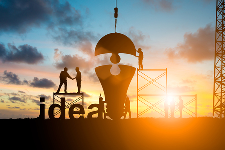 Silhouette Business people shaking hands and Team business engineer work connecting jigsaw puzzle piece together. idea of progress over blurred natural.Teamwork potential and motivate growth concept Archivio Fotografico