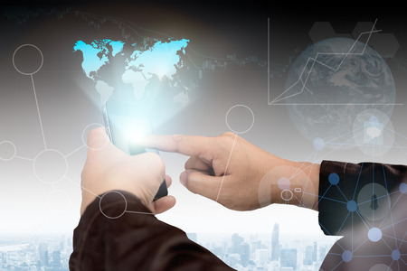 payable: Business,communications,connection,technology concept.businessman using smartphone Show map image holograms. Global Strategy Virtual Icon.Innovation Graphs Interfaces.Analyze market stock over blurred city scape.select focus.flare light